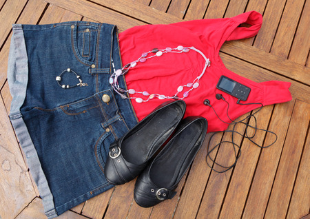 Woman clothes and shoes for summer with jewels and mp3 player Stock Photo