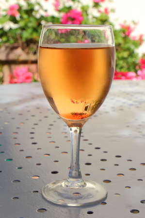Glass of kir for aperitif on a metal table in a garden Stock fotó