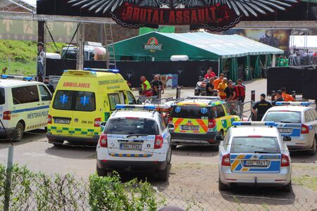 JAROMER - CZECH REPUBLIC, AUGUST 09 : Police cars and ambulances near Brutal Assault festival entrance for evacuation of an injured person, August 09, 2017
