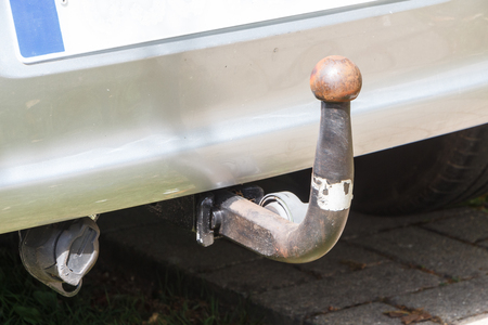 Close-up on the trailer hitch ball of a car
