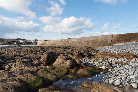 Coast and breakwater of Le Loch harbor in Primelin at low tide 写真素材