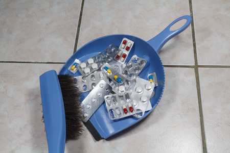 To throw away old packs of pills with a brush and a dustpan