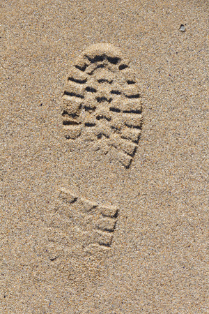 Footprint on the sand of a beach in Brittany