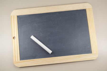 Chalkboard slate with wooden frame and white chalk