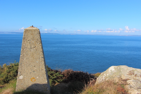 Beacon near the sea on breton coast Imagens