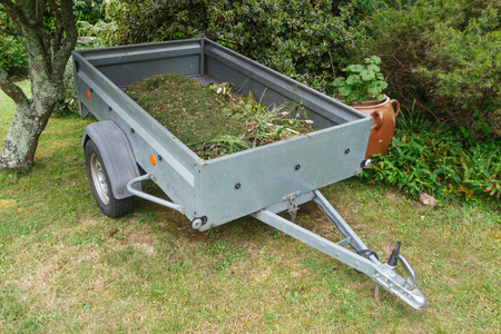 Trailer full of garden waste and lawn mowing