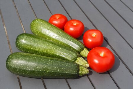 Summer vegetables, whole tomatoes and zucchinis