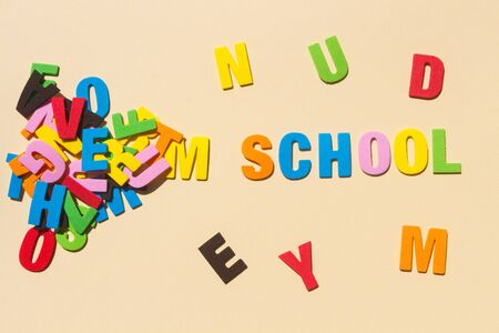 School written with colored letters and heap of letters Stockfoto