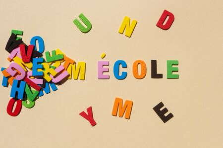 School written in french language with colored letters Stockfoto