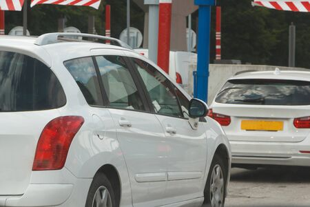 Cars waiting to pay at the tollbooth in France Zdjęcie Seryjne - 129217648