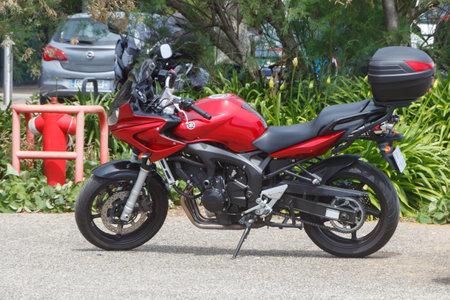 GUIPAVAS, FRANCE – JUNE 01 : Red modern Yamaha motorbike parked, June 01, 2019