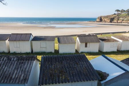 Ris beach and white sheds in Douarnenez