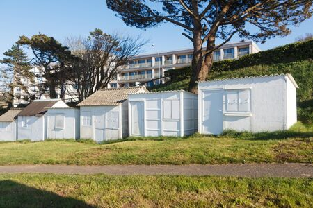 White beach sheds at Ris beach in Douarnenez