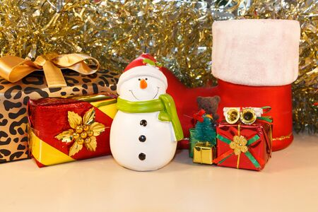 Snowman figurine and gifts as decoration for Christmas