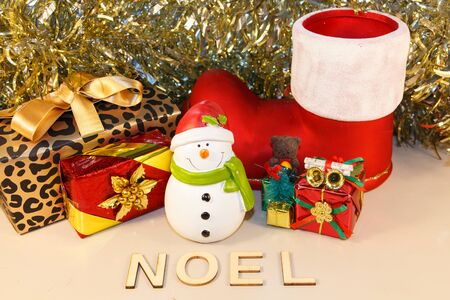 Snowman figurine, gifts and the word Christmas in french language