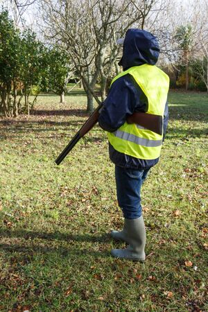 Hunter with its rifle under his arm during autumn