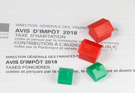 French housing and property tax written in french language and small houses Imagens - 132682365