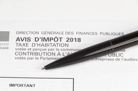 Housing tax and tax notice written in french language and pen Imagens - 132682375