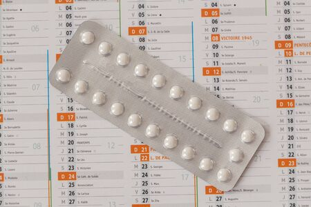 Pack of contraceptive pills and calendar