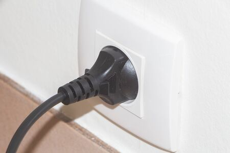 Plug in a socket in the wall of an house