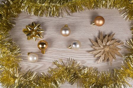 Tinsel and golden bauble as decoration for Christmas