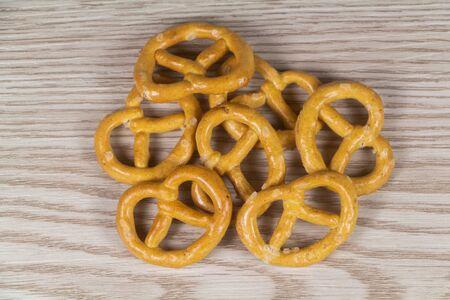 Bretzel biscuits for appetizer on wooden background