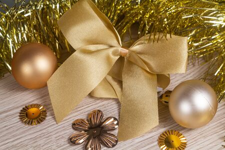 Bow and golden baubles as decoration for Christmas