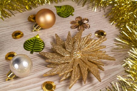 Tinsel, star and golden baubles as decoration for Christmas