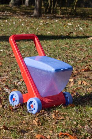 Outdoor toy, red and blue wheelbarrow in plastic
