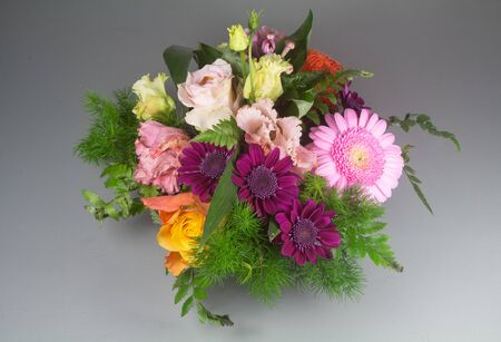 Flowers arrangement with roses and gerberas