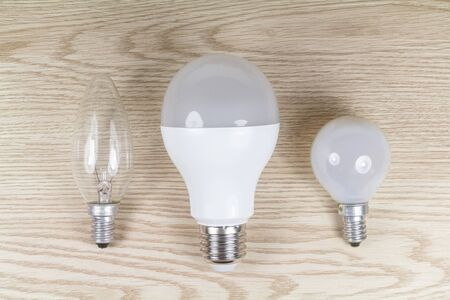 Different shapes of bulbs on wooden background