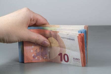 Euro banknotes in the hand of a woman