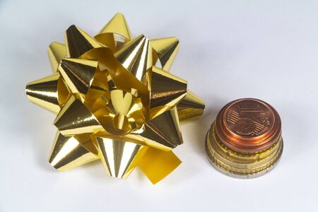 Euro coins and bow as gift for Christmas or birthday