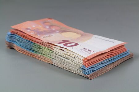 Heap of banknotes of ten, twenty and fifty euros