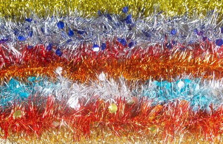 Multicolored Christmas tinsel in a line