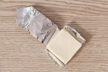 Open portion of processed cheese with emmenthal
