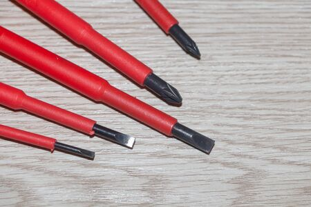 Professional electrician set with five red screwdrivers Imagens