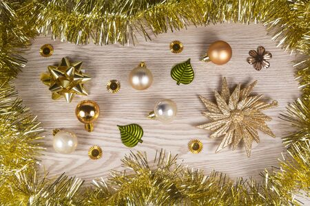 Tinsel, star, bow and golden baubles as decoration for Christmas Stock Photo