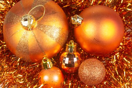 Orange baubles on tinsel as decoration for Christmas