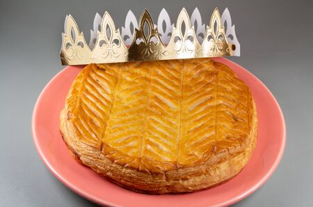 French king cake on a red dish and crown