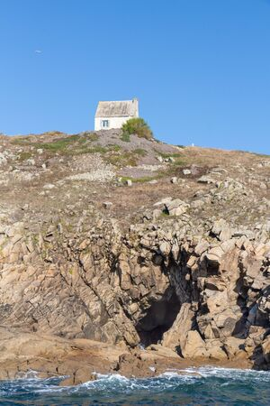 Coast in Brittany with an house on its top