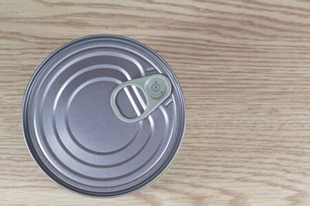 Tin can view from above on wooden background 版權商用圖片