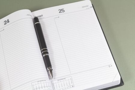Open empty diary and black fountain pen