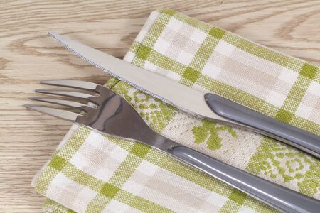 Fork, knife made in stainless steel and green and white napkin 版權商用圖片