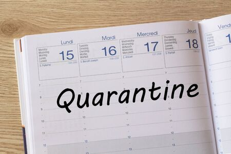 Quarantine written on a weekly page of a diary