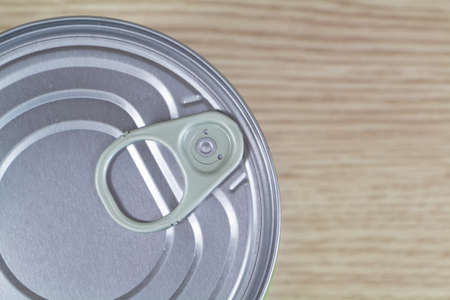 View from above of a tin can on wooden background