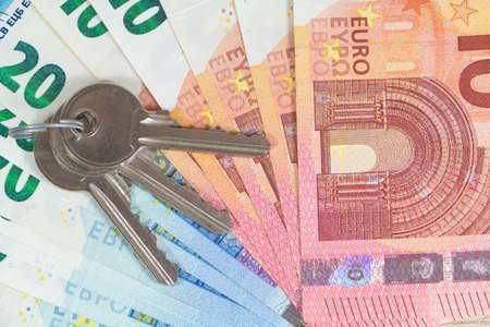 Keys and banknotes of ten and twenty euros