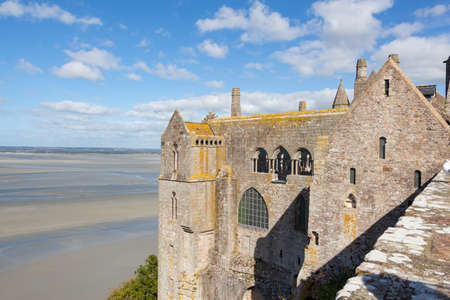 Wall of the Abbey of Mont Saint-Michel and bay at low tide