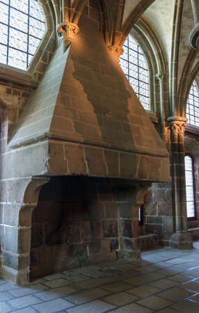 Fireplace made in stone in the abbey of Mont Saint-Michel Editorial