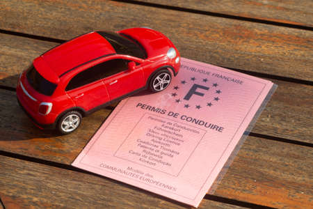 French driving license and toy car 版權商用圖片